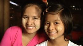 Mum and daughter wearing thanaka