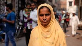 Mushtari Khatoon standing in a street