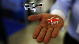 A man shows a mini drone.