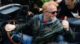 Chris Evans leaves the BBC Radio studios in London, in his vintage Aston Martin, after he was announced as the new Top Gear presenter.