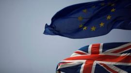 The Union Jack (bottom) and the European Union flag are seen flying
