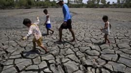 The cracked soil of a dried up fishery in the Philippines in South east Asia