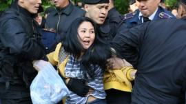 "Kazakh police officers detain opposition protesters in Almaty on May 1, 2019. - Dozens of protesters opposed to Kazakhstan""s authoritarian regime were arrested by police in the largest city Almaty on Wednesday after decrying a snap election critics liken to a succession plan."
