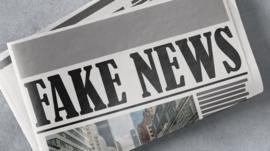 Newspaper with 'Fake News' headline
