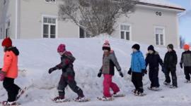 Children walking in Ii, Finland