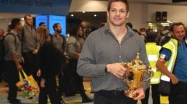 All Blacks captain Richie McCaw arrives back home with the Rugby World Cup trophy at Auckland Airport