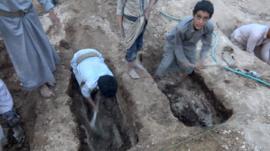 Children digging grave