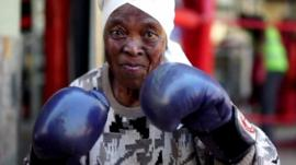 Zodwa Twala, 75 years old, raises her gloves
