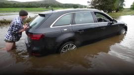Farmer pushing car from flood water in North Yorkshire