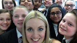 Hayley with school pupils