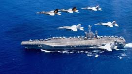 يو إس إس ستينيس تجري العمليات في بحر الفلبين في 18 يونيو/حزيران 2016