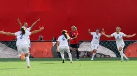 England women's football team celebrating