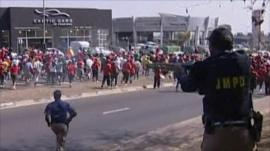 South African Police firing rubber bullets