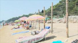 A fence divides the public and private beach in Gaeta