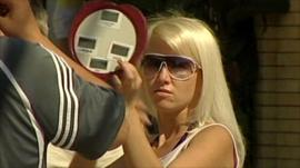Sochi holidaymaker looking in mirror