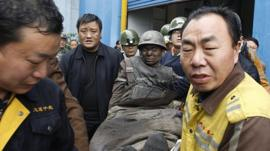 A miner is rescued from the mine in in Samenxia