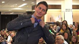 A male model wearing geek chic clothing