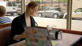 Suzanne Vega in the restaurant where she wrote Tom's Diner