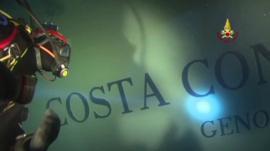 Diver inspects Costa Concordia hull
