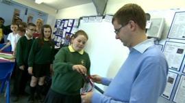 School pupils handing in their phones
