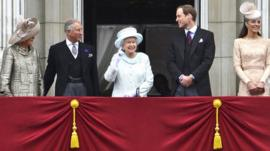 The Queen standing on Buckingham Palace balcony