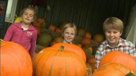 Children with their pumpkins.