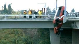 Car dangling over road in Beaverton, Oregon