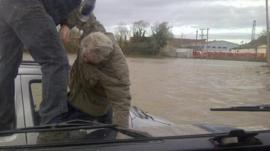 David Dunn pulls an elderly man from his car as it sinks in flood water at Keynsham