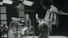 Jimi Hendrix playing guitar