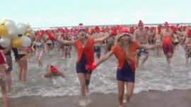 People run to take a bath in the North Sea