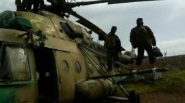 Rebels standing on a helicopter
