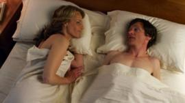 Helen Hunt, left, and John Hawkes in a scene from The Sessions
