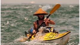 Jason Lewis in a kayak