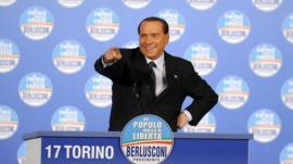 Former Italian Prime Minister Silvio Berlusconi gestures during a political rally in Turin