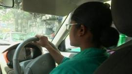 A female Indian cab driver