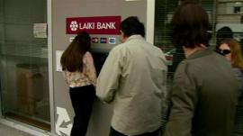 Cypriots waiting to withdraw cash from a cash machine