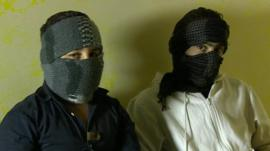 Two boys, faces covered