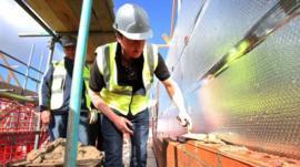 David Cameron laying bricks