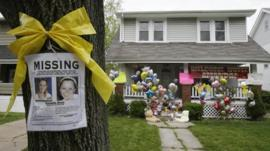 Missing poster, balloons ad tributes left outside Amanda Berry's home