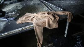 Clothes, produced in a factory belonging to Tung Hai Group, a large garment exporter, are seen after a fire in Dhaka