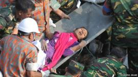 Woman pulled alive from Dhaka rubble - Photo courtesy Shariful Islam