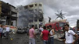 People gather at the site of an explosion in the town of Reyhanli near the Turkish-Syrian border