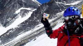 80 year-old Japanese adventurer Yuichiro Miura poses on Mount Everest