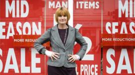 Mary Portas stands outside a shop with sale signs