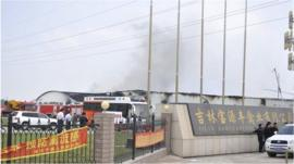 Smoke rises from a poultry farm at the Jilin Baoyuanfeng Poultry Company in Mishazi.