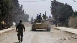 Forces of Syrian President Bashar al-Assad are seen in Qusair village May 30