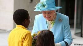 The Queen receives her posy from 7-year-olds Ayda and Tai-Tai