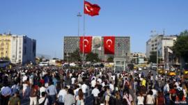 Protesters in Istanbul's Taksim Square, facing Ataturk Cultural Center
