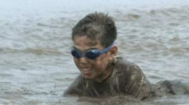 Child playing in mud in Ono City in Japan