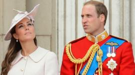 The Duchess and Duke of Cambridge stand on the balcony at Buckingham Palace during the Trooping the Colour parade 2013